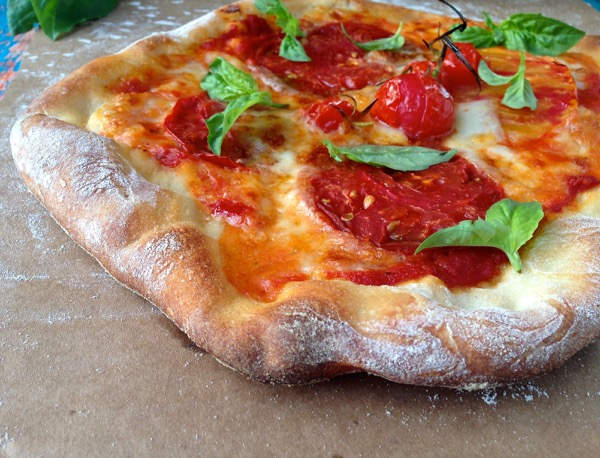 Thin Crispy Crust Italian Pizza Pie with Cheese, Tomatoes and Basil