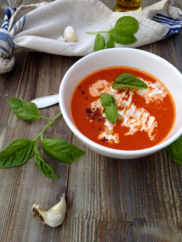 White Bowl of San Marzano Tomato Soup on a Rustic Table