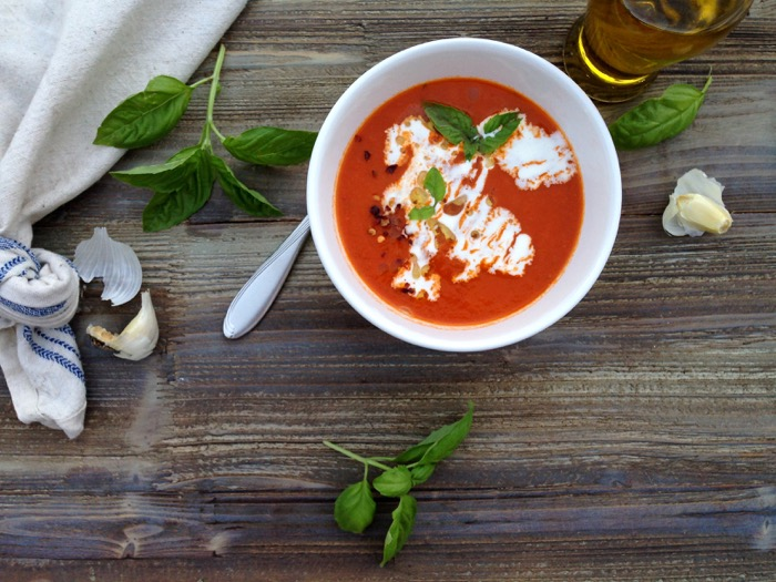 Bowl of San Marzano Tomato Soup with a Swirl of Cream and Fresh Basil