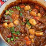 Red Pot Of Beef Stew with Gnocchi Dumplings