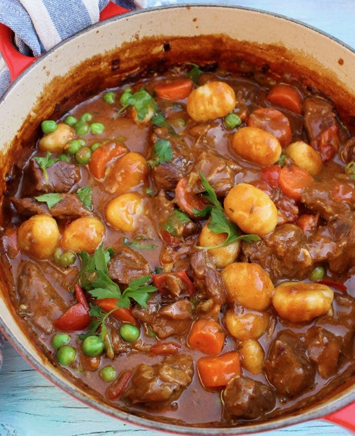Red Pot of Homemade Beef Stew with Gnocchi Dumplings