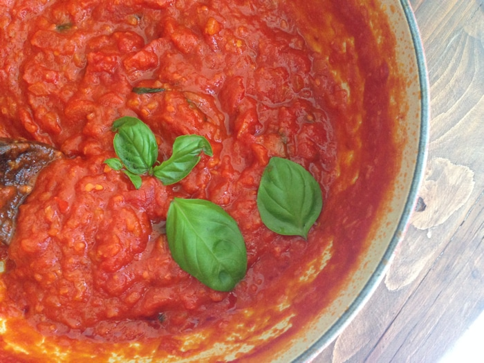 Red Bowl Of Spicy Arrabiata Sauce with Basil