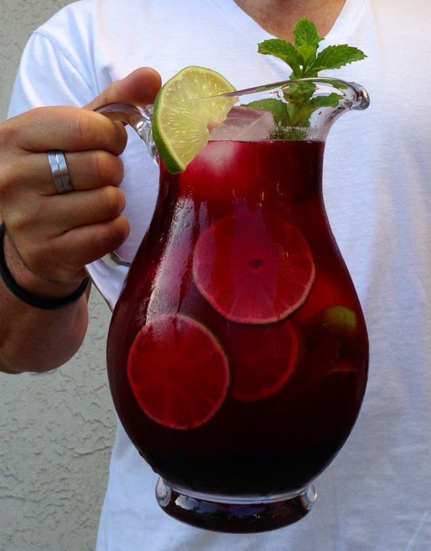 Man Holding a Pitcher of Blueberry Limeade