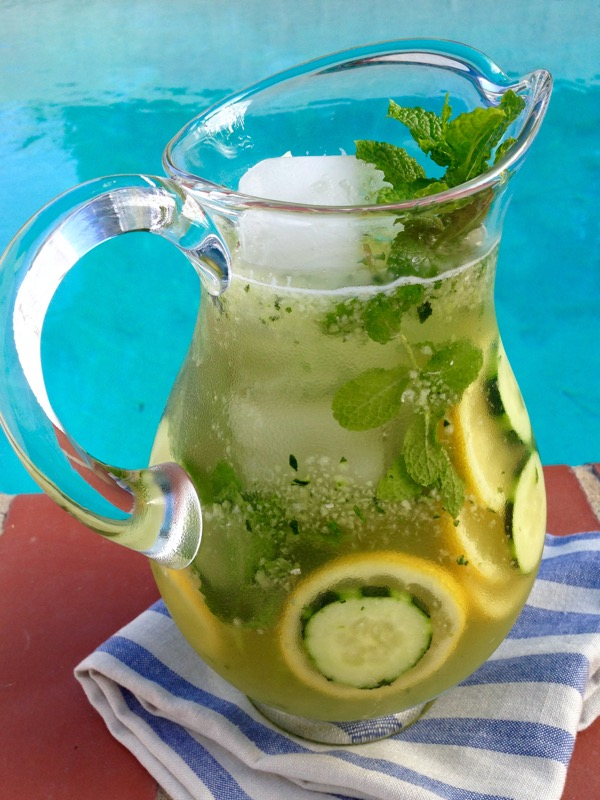 Pitcher of Cucumber Lemonade over Ice with Mint and Honey, Sliced Cucumber and Lemons