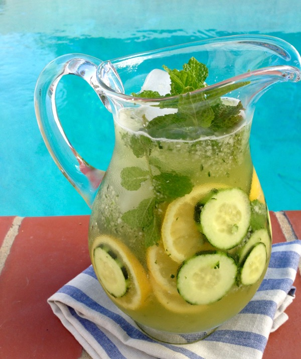 Pitcher of Cucumber Lemonade over Ice with Mint and Honey by the Pool