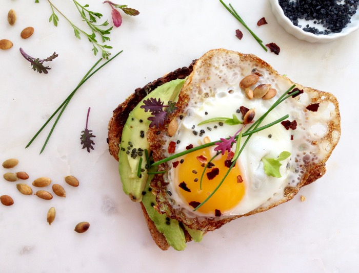 Avocado Toast Breakfast with Egg, Herbs and Red Pepper Flakes