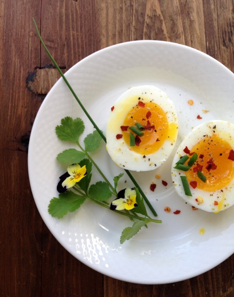 Perfect Soft Boiled Eggs with Herbs and Spices on a Rustic Table
