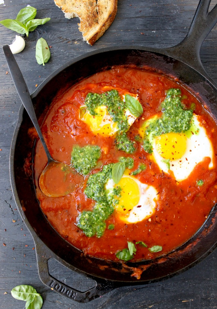 Skillet of Uova in Purgatorio or Eggs in Purgatory in Arrabiata Sauce with Pesto and Bruschetta