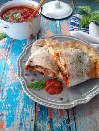 Chicken Calzone with Arrabiata Sauce on a Rustic Table