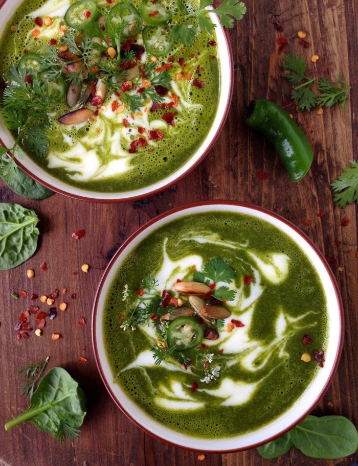 White Bowls of Vegetarian Kale Soup on a Wood Table
