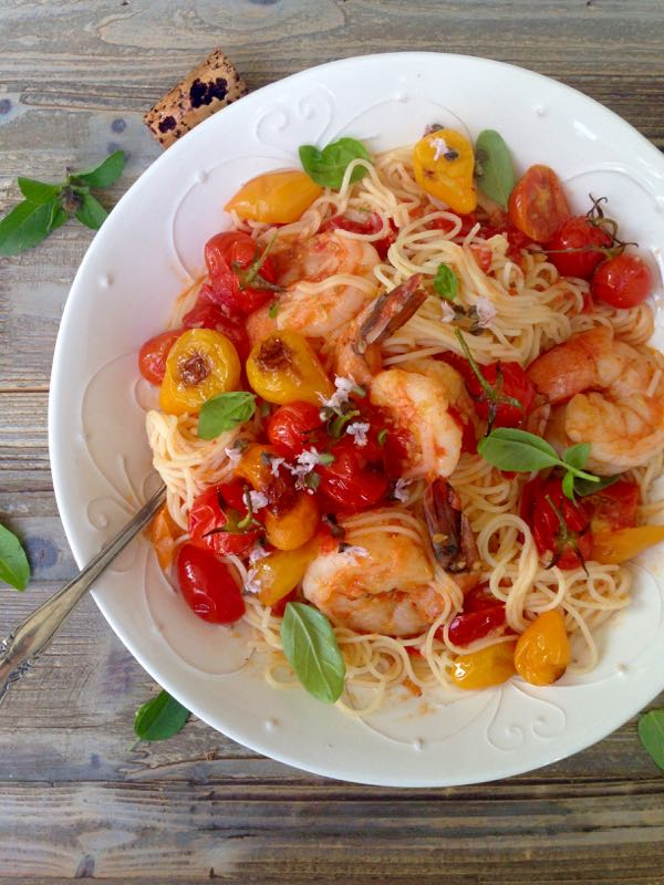 Serving Bowl of Fresh Tomato Basil Sauce with Shrimp Capellini on a Rustic Table