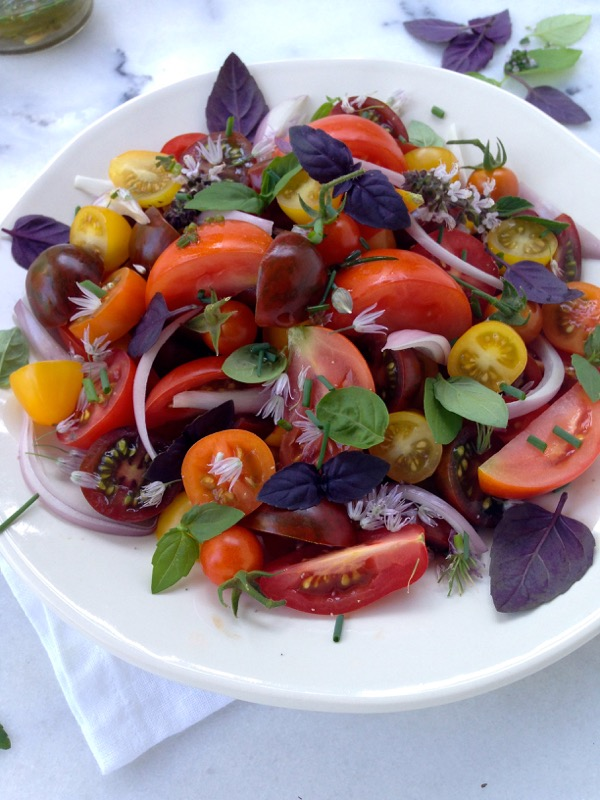 White Bowl Of Tomato Basil Salad with Chive Vinaigrette, Purple and Green Basils and Chive Blossoms