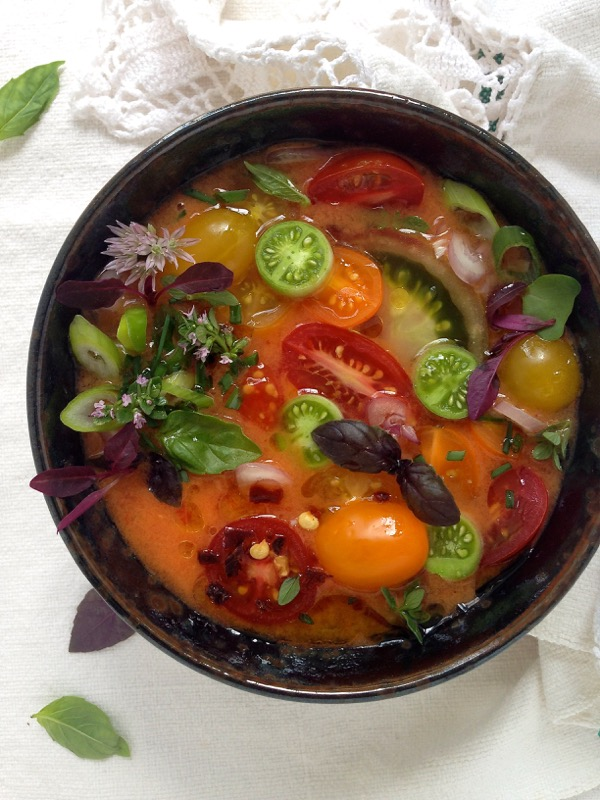 Bowl of Heirloom Tomato Gazpacho Soup with Basil and Herbs