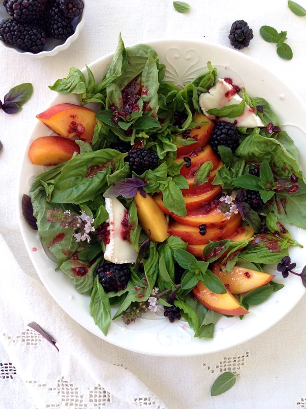 Bowl of Peach Salad with Basil and Blackberry Vinaigrette