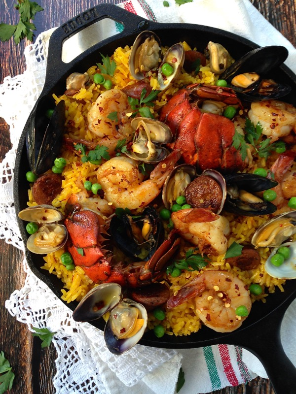 Seafood Spanish Paella in a Cast Iron Pan with Lobster and Shrimp