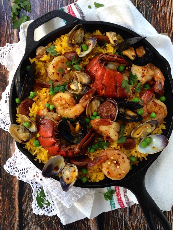 Lobster, Shrimp and Clams Paella in a Cast Iron Pan