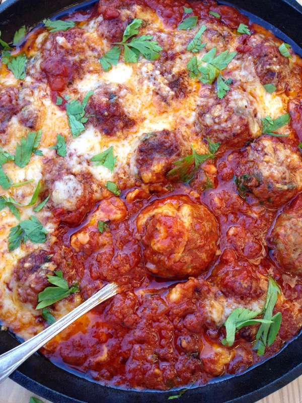 Italian Ricotta Meatballs in Arrabiata Sauce covered in Melted Fontina Cheese