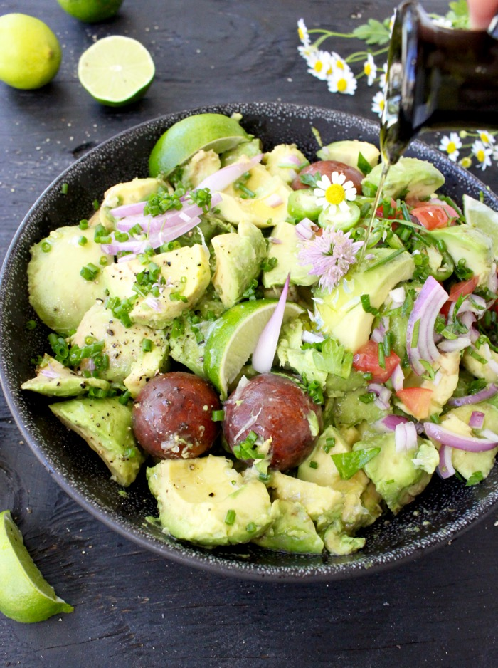Large Bowl of Healthy Homemade Guacamole on a Rustic Table