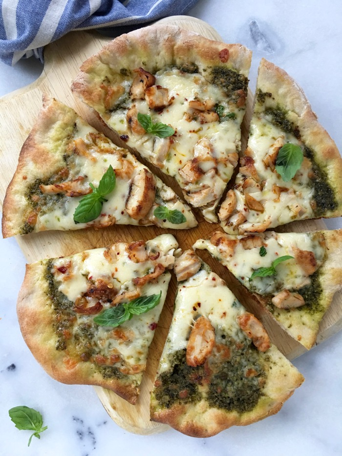 Chicken Pesto Pizza on a Cutting Board