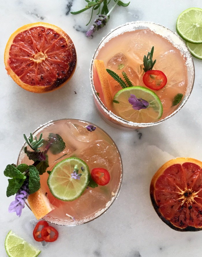 Glasses of Grapefruit Mojito with Red Chili, Lime and Lavender Flowers