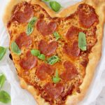 Pepperoni Pizza in the Shape of a Heart on a Marble Board