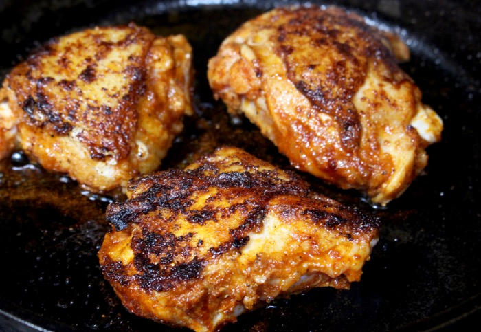 golden brown cast iron seared chicken thighs