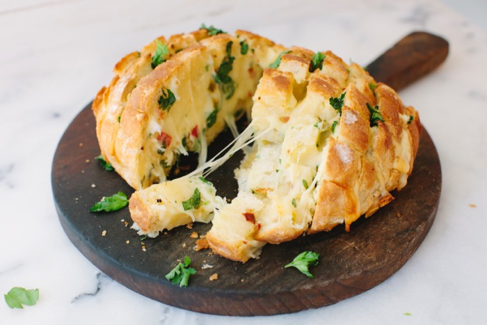 Cheesy Garlic Bread on a Wood Cutting Board