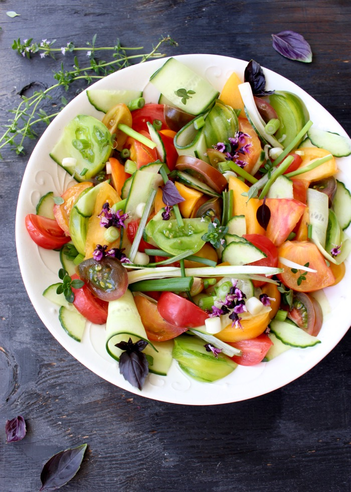 White Rustic Bowl of Cucumber Tomato Salad with Basil and Onions