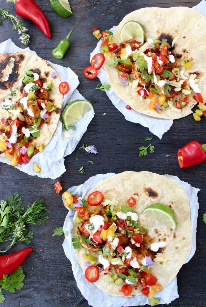 Mexican Shrimp Tacos with Heirloom Tomato Salsa on a Black Wooden Board