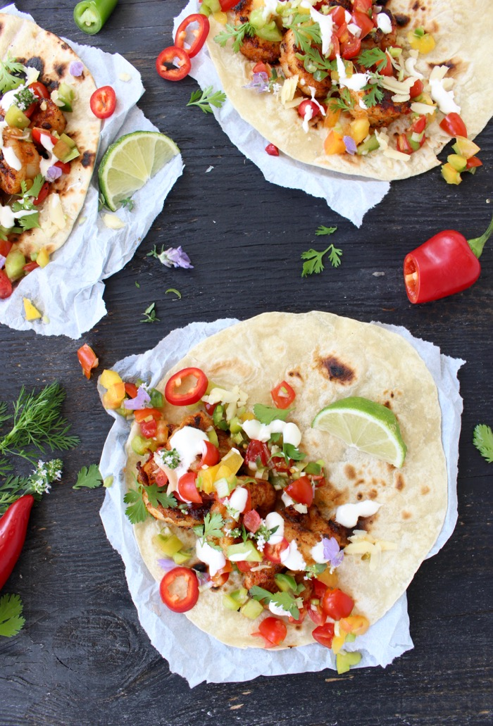 Mexican Style Shrimp Tacos on a Wood Table