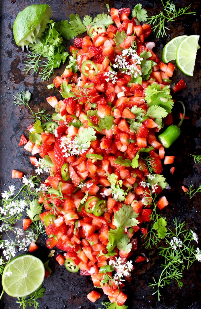 Black Serving Platter of Strawberry Salsa with Limes and White Blossoms