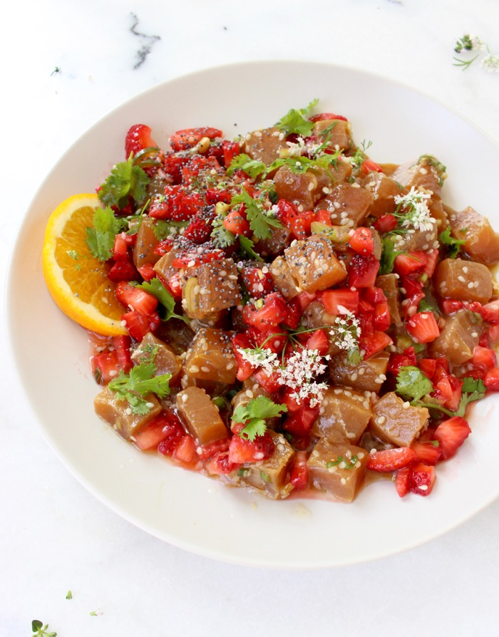 White Bowl of Hawaiian Poke with Strawberry Salsa and Sesame Seeds