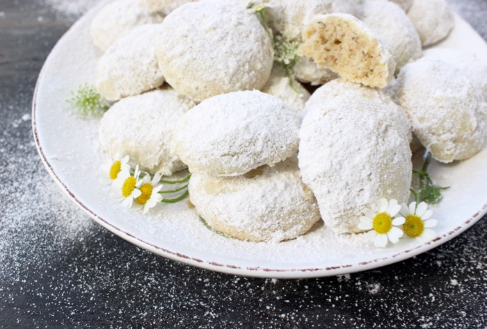 White Serving Tray of Italian Wedding Cookies Coated in Powdered Sugar