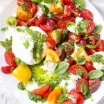 A White Platter of Heirloom Tomatoes, Burrata and Basil Pesto