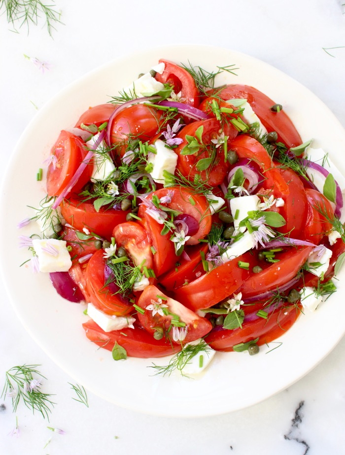 White Bowl of Red Tomato Onion Salad with Feta Cheese, Oregano and Chives