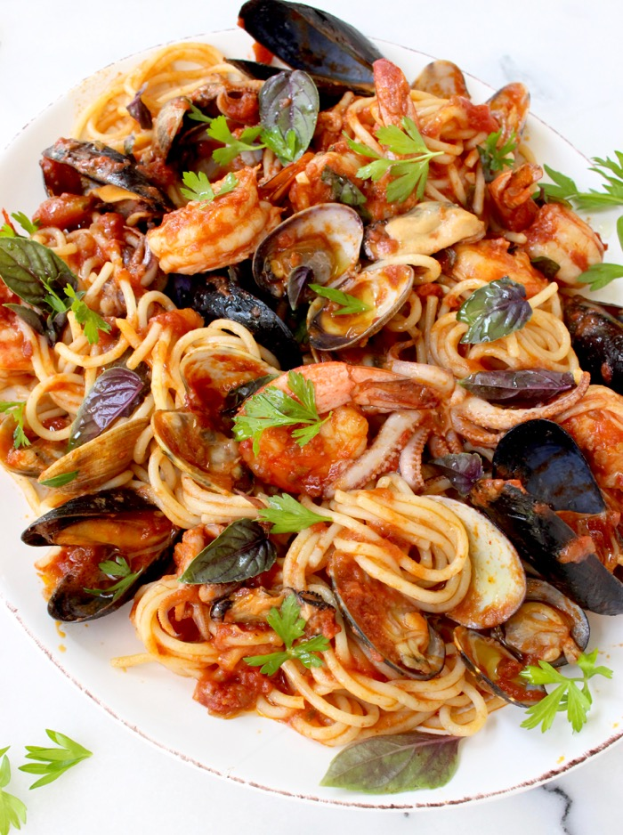 Serving Plate of Spaghetti Frutti di Mare with a Mix of Seafood: Clams, Mussels, Shrimp and Squid