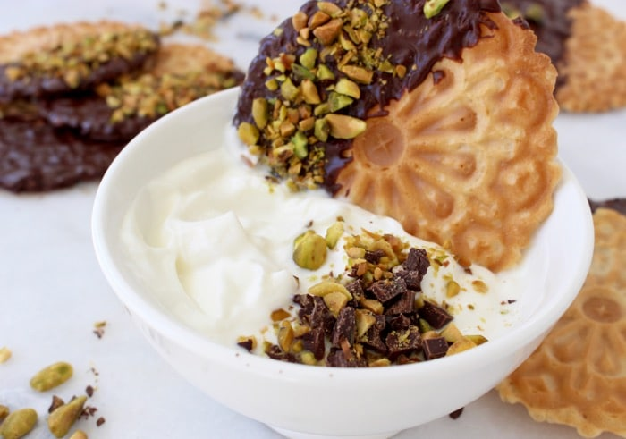White Bowl of Whipped Cannoli Filling or Dip with Chocolate Pistachio Pizzelle