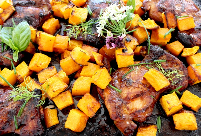 Honey Balsamic Chicken Thighs with Roasted Butternut Squash on a Cookie Sheet