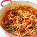 Red Bowl of Spaghetti in Puttanesca Sauce