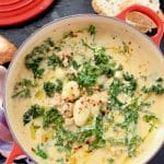 Red Bowl of Gnocchi Zuppa Italian Soup with Kale and Sausage