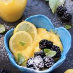 Blue Bowl of Lemon Curd with Blackberries, Basil and Powdered Sugar