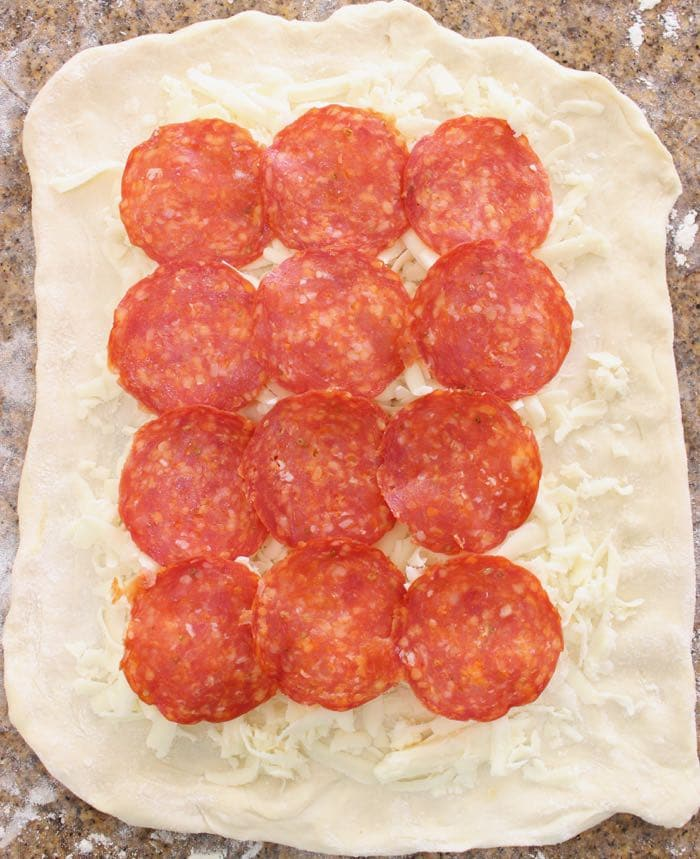 Stromboli dough layered with pepperoni and cheese