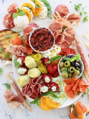Italian Style Antipasto Platter with Roasted Peppers, Tapenade, Prosciutto, Salami, Smoked Salmon