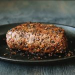 Peppercorn crusted Steak on a Cast iron Skillet
