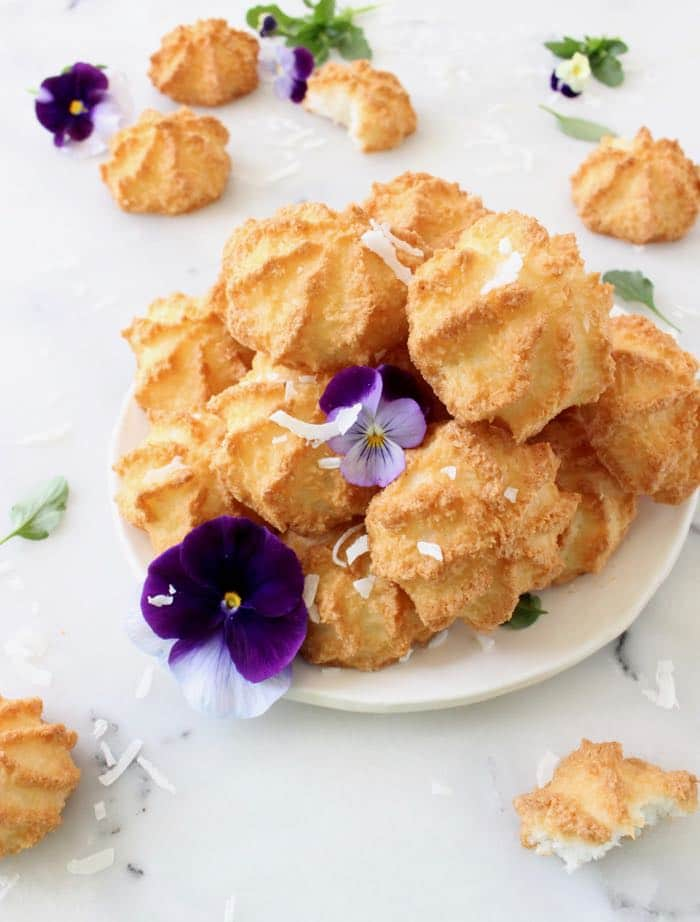 Photo of Coconut Macaroons Garnished with Shredded Coconut and Violas