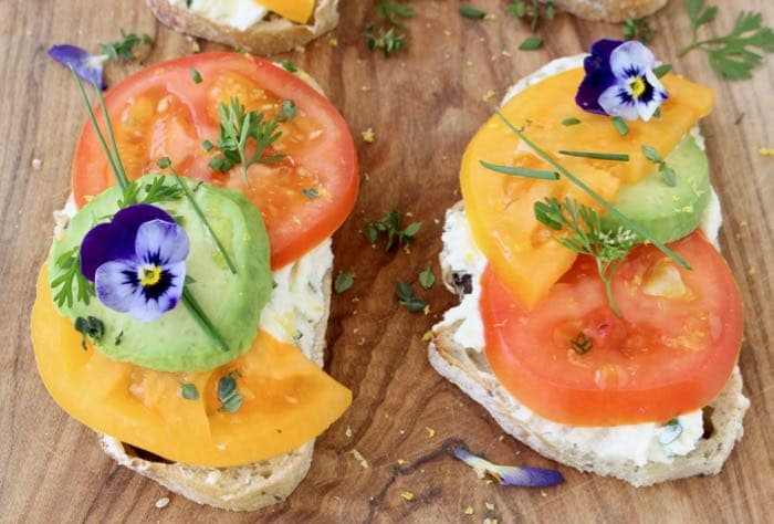 Open Faced Tomato Sandwich with Goat Cheese on Wooden Board