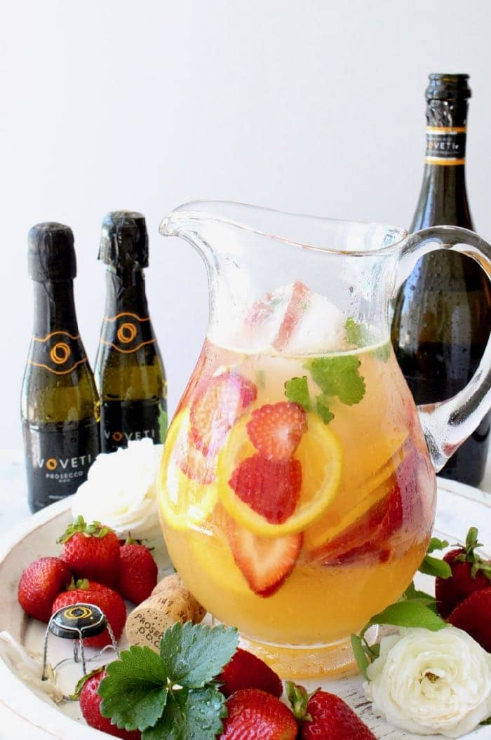 Pitcher of strawberry sangria with oranges and white wine