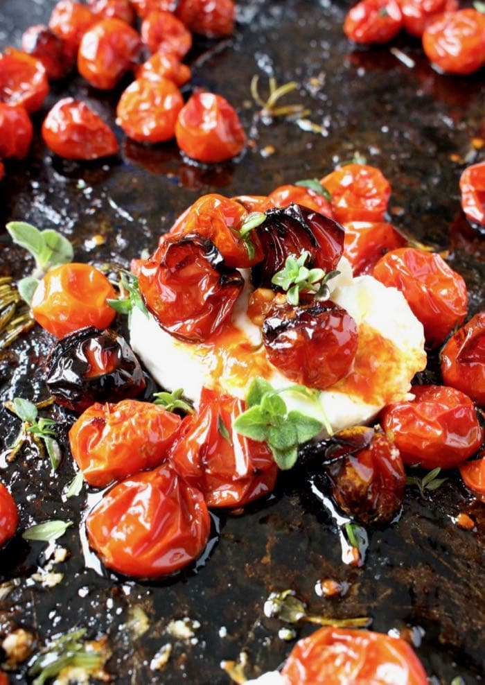 Oven Roasted Cherry Tomatoes with Thyme, Rosemary and Goat Cheese.
