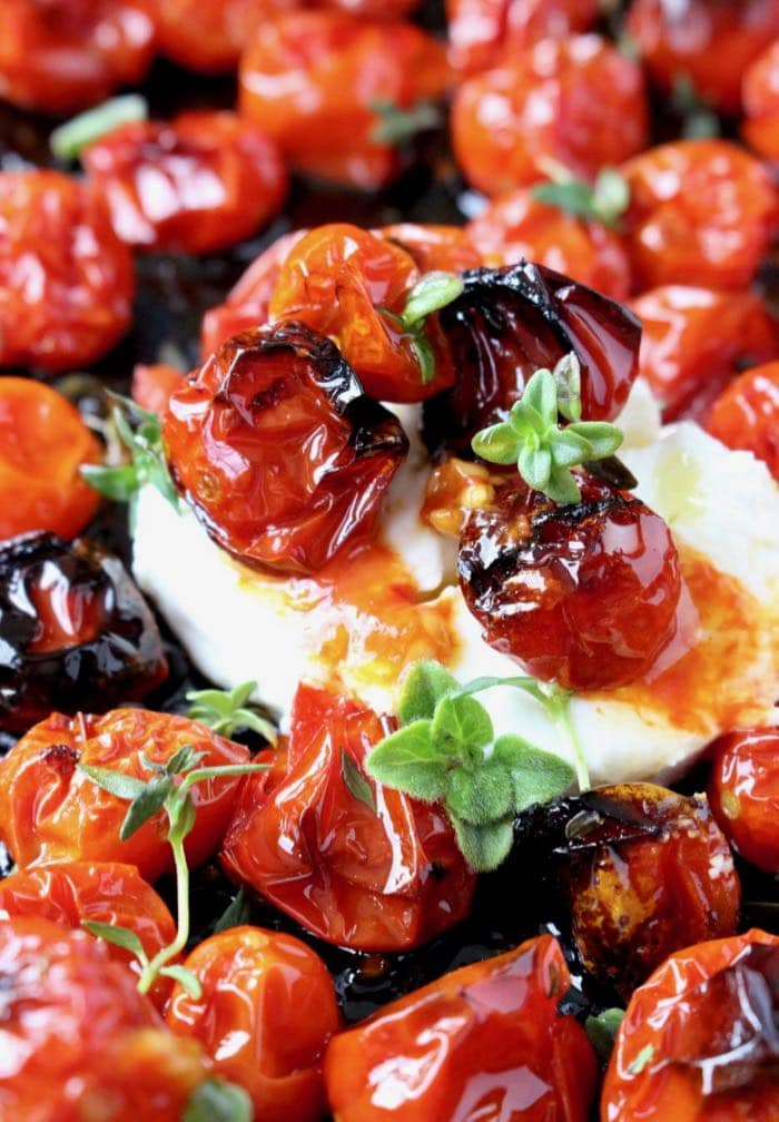 Oven Roasted Tomatoes with Thyme, Rosemary and Goat Cheese.