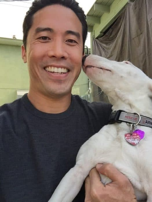 Marc Ching with Rescued Dog